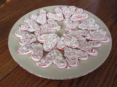 White chocolate candy hearts for Valentine's day. (Uses mini candy canes from clearance Christmas candy.)
