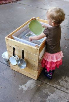 "Outside kitchen - good for water, mud or sand.  ""I want to give my kids more reasons to be outside than inside (when it's practical). I want them to learn through play and spend time in their imaginations. This is just one of the ways I can fulfill my need to create while encouraging theirs. """