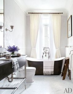 New York bathroom - home of Brooke Shields (Via AD). Love the tub in front of the window