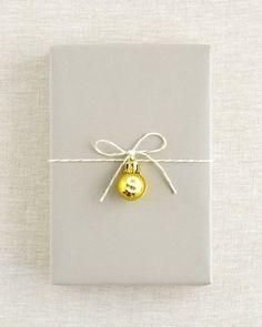 Sweet & simple gift wrapping! 10 Awesome Ways to Decorate With Leftover Christmas Ornaments