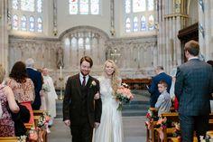 Bride wears a bespoke wedding dress by Rowan Joy | Photography by http://www.caroweiss.com/