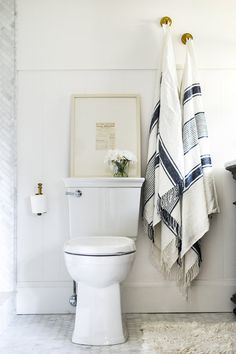 Blue & White Turkish Towels in White Marble Bathroom   boxwoodavenue.com