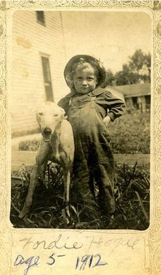 Great picture, but fabulous name--Fordie Hogue. Fordie Hogue poses with his dog. Vintage Photos I Love.