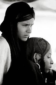 1969 in the Sahel. Two beautiful  Tuareg girls sheltering in their tent from the mid-day sun.--Fascinating Humanity