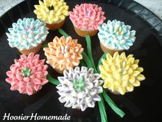 Mini colored marshmallows cut diagonally and dipped in color sugar with candy in the middle.