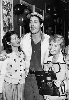 rare carrie fisher | Carrie Fisher, Chevy Chase and Debbie Reynolds at a Halloween party ...