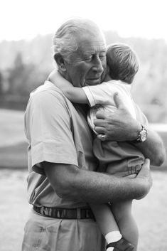To mark the birthday of Prince Louis, Clarence House shared a picture in which Prince Charles of Wales is hugging Prince Louis of Cambridge