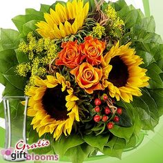 Flower Bouquet Vincent with vase & Lindt Chocolate - [1968]  Sunflowers and roses a colourful composition.Your flower bouquet includes 3 orange roses, 3 sunflowers, 2 yellow bast cuff, plenty of greens, 1 package of flower nutrients and nursing instructions.