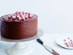 Triple-Layer Sour Cream Chocolate Cake | This mega chocolate cake is perfect for any special occasion. Get the recipe on Food & Wine.