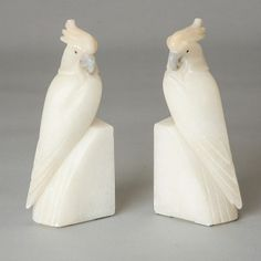Pair Art Deco Italian Alabaster Cockatoo Bookends  --  Pair circa 1940s Italian hand carved alabaster parrot / cockatoo book ends.  --   Item:  5202  --  Retail Price:   $395