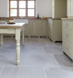 Eiffel grey limestone flagstones in the kitchen from Ca' Pietra.  Like the color