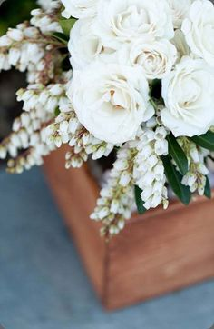 Centerpieces will be wooden boxes with neutral and blush flowers
