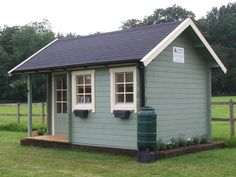 Perfect Cabins Show Cabin. Rain barrel, flowerbed, flowerboxes.