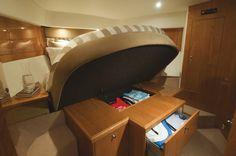 Riviera 63 Enclosed Flybridge Series II - Shaft Drive | Underbed Storage