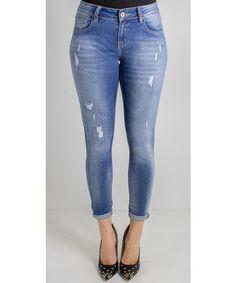 Jeans skinny effetto strappato dalla vestibilità slim.