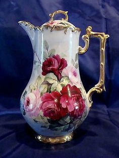 This is a T & V Limoges France Depose Chocolate pot with beautiful hand painted roses and gold trimming sign by W. Wilson which is located under the roses. The pot stands approximately 10 tall from Bistro Design, Sugar Bowl, Teapot Cake, Tea Sets Vintage, Antique Signs, Tea Pot Set, Teapots And Cups, Chocolate Pots, Chocolate Coffee