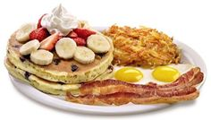 Denny's Double Berry Banana Pancakes – Two new fluffy buttermilk pancakes with juicy blueberries cooked inside and topped with fresh strawberries and bananas