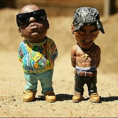 Figurines of Biggie and Pac