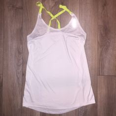 Reebok racerback athletic play dry tank Reebok Play dry athletic tank size medium. Great for CrossFit WODs, running or any workout!  has reflective spots and a white mesh type back with neon yellow removable straps.  Front: 52% recycled polyester 48% polyester. Back: 100% polyester.  Worn once - perfect condition - smoke free home. Reebok Tops Tank Tops