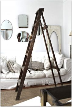 A great vintage ladder!!! Like the mirrors on the wall too!
