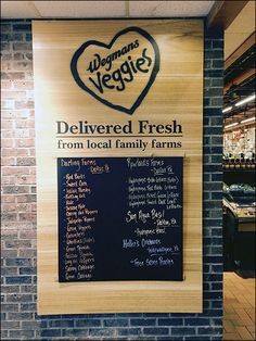 Local Farm delivery is not only promised by Wegmans®, but identified by handwritten product and farm as you enter the produce department. Farm offerings are also coded in color chalk on the chalkbo...