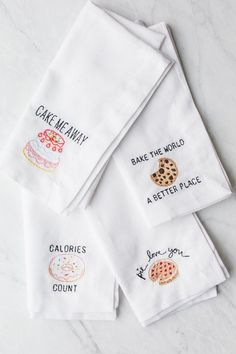 "Set of four iconic baked goods lover embroidered designs including ""Cake me away, Calories (donut) count, Bake the world a better place, Pie love you"" on cotton napkins with mitered corners and 1 Visit our site for Fiesta Bake Set Embroidered Gifts, Embroidered Towels, Embroidery Stitches, Hand Embroidery, Machine Embroidery, Cotton Napkins, Napkins Set, Bakery Puns, Homemade Anniversary Gifts"