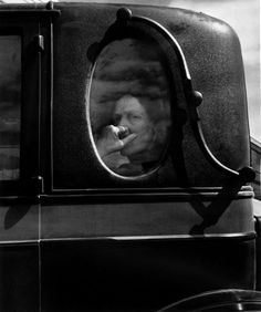 Dorothea Lange: Funeral Cortege, End of an era in a small valley town, California, 1938
