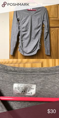 Athleta Long Sleeve Workout Top Like new. I wore once and washed. A little too big for me! Stretches on the sides to be form fitting, not ruched like the picture only when hanging up. Athleta Tops Tees - Long Sleeve