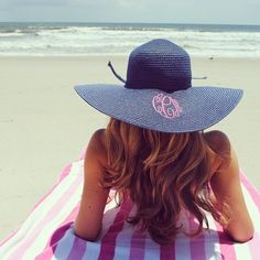 perfect monogrammed hat laying out at the beach... lets go there now.