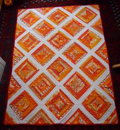 Orange string quilt   just beautiful!  (maybe do with batiks?)