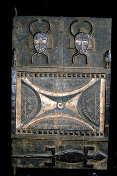 Africa | House door from the Senufo people of the Ivory Coast | Carved wood