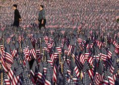 Uncommon memorial  People walk through the Boston Common covered with American flags, in Boston on May 23. Relatives and volunteers planted 33,000 flags in the historic park in advance of the Memorial Day weekend, in tribute to Massachusetts soldiers killed in conflicts as far back as the Civil War.