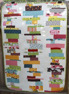 """This quilt reminds me of stacks of books.  And if you have ever seen my living room you would know that this would tie in nicely with our """"decor"""".  :)  So I think I need to make this."""