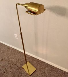 For your consideration is a lovely Koch and Lowey mid-century floor lamp. The lamp is height adjustable and the head swivels and tilts. In good