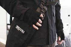 ARC'TERYX VEILANCE LT field jacket.  WHITE MOUNTAINEERING BLK Schoeller gloves.  ACRONYM 3A-3TS bag.