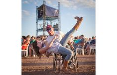Brian McPherson dips his friend Allyson Lowe while dancing to Travis Tritt's performance at the main stage on the third day of the Big Valley Jamboree in Camrose, Alta. on August 3, 2013.
