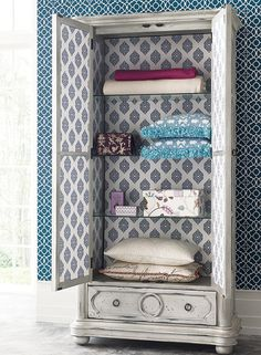Update an armoire by wallpapering the inside! New wallpapers by Waverly!