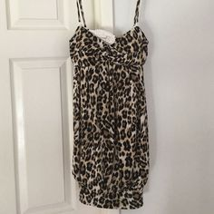 Leopard dress Size medium ...95% polyester/ 5% spandex.  Super sexy.  Straps can be taken off. Speechless Dresses Mini