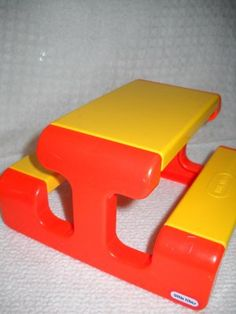 Little Tikes table!  So, I had one in my bedroom, next to my little tikes kitchen....because I had to have a place to seat and serve my family & guests....duh.