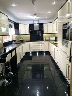 White Gloss Kitchen With Black Worktops on black with white doors, black with white kitchen floor, black with white drawers,