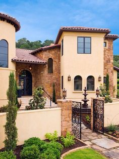 I would love to incorporate traditional Mediterranean architecture in a modern fashion. Such as a courtyard, outer gates, use of cobblestone, different stones, the door arches, and layout.
