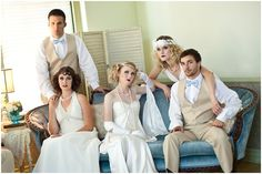 Gatsby Party Styled Shoot Wedding Party pose on powder blue couch Dresses and Tuxes from Lauren James Bridal and Formal. laurenjamebridal.com