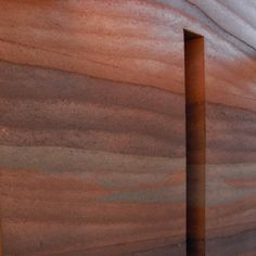 Rammed earth wall with three colors of material interwoven. this is just naturally beautiful