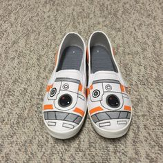 These Star Wars inspired slip-on canvas shoes are a great addition to any science fiction lovers wardrobe. These shoes, styled after the new droid in the Star Wars universe, BB8, are a unique addition to any Star Wars and movie lovers wardrobe and are sure to spark great conversations. These shoes are also available in childrens and mens sizing, just message before purchasing for more details. All shoes are hand-painted to order and sprayed with a water-proof sealant to protect them from…