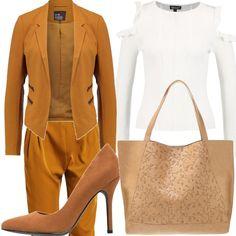 Pantaloni eleganti, maglione bianco con scollo rotondo, blazer color senape, scarpe cognac con tacco a spillo, borsa beige chiaro! Insomma i colori dell'autunno!