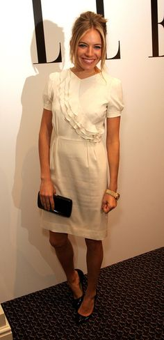 Sienna Miller Cocktail Dress - Sienna Miller attended the 'Edge of Love' private VIP party looking demure in a little white dress with a cascade of ruffles down the bodice.