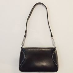 """Black Shoulder Bag This shoulder bag is in great condition. // inside is clean, fully lined with two inside pockets and one inside zipper pocket // no holes, stains or imperfections // comes from a smoke free environment // 9"""" W x 5"""" H x 2.5"""" D 📦Bundles welcome 👌🏻Offers welcome through offer button ❌NO trades, please. ⚡️Same/Next day shipping Wilsons Leather Bags Shoulder Bags"""