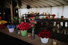 Vibrant arrangements of spring/summer florals placed in colourful vase combinations added warmth and fun to this luxurious picnic party setting....   The exquisite darcy garden roses, green button mums, vibrant pink peonies, orange ranunculus, hyacinth and super nova roses contrasted beautifully with the mahogany furniture within this fun pre-wedding day party marquee.  #oliviabuckleyinternational #eventdesigners #eventplanners #weddingplanner #corporatevents #eventmanagement #partyplanner Wedding Events, Wedding Day, Super Nova, Mahogany Furniture, Garden Roses, Green Button, Ranunculus, Event Management, Pink Peonies