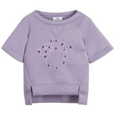 Girls lilac neoprene sweatshirt from Young Versace. The fabric has a soft spongy feel, with short sleeves and a pretty embroidered Medusa head and designer logo on the front, with floral appliqué that have sequin centres. The hemline is longer at the back and has v-shaped inserts at the front, with a grey marl lining.