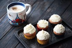 Soy milk caffe Latte in the Starbucks You Are Here Paris mug & vanilla frosting cupcakes.